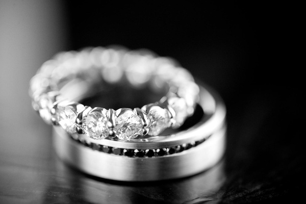 Black and white photo of diamond eternity band