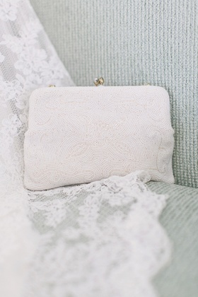 Bride's white clutch with beads and gold hardware
