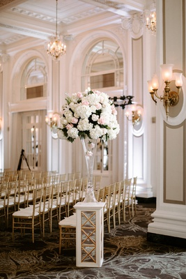 wedding ceremony tall centerpiece on riser pink rose white rose hydrangea gold sconces gold chairs