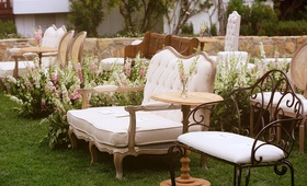wrought iron benches, tufted couches, chairs, intimate ceremony