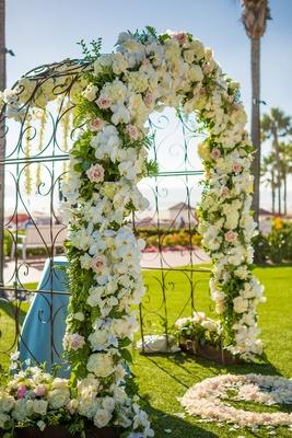 wrought iron arch facade florals orchids roses beach grass lawn hotel del coronado
