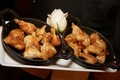 Wedding reception appetizer purses of crispy dough in cast iron pans