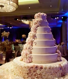 Round cake adorned with cascading sugar flowers