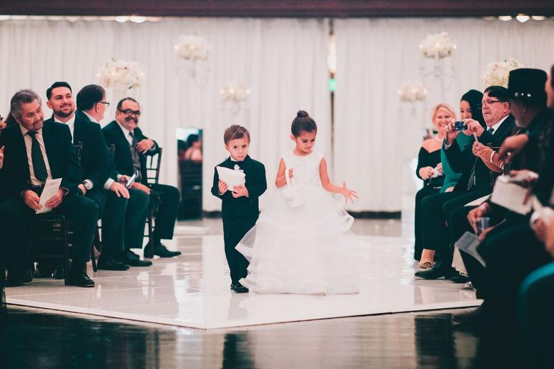 vibiana wedding ceremony drapery white flowers ring bearer and flower girl formal attire