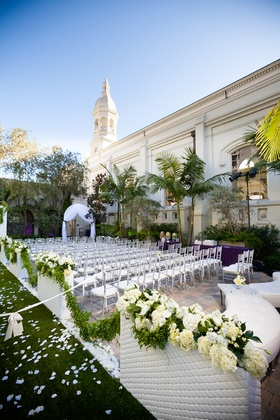 Outdoor wedding venue with lounge chairs