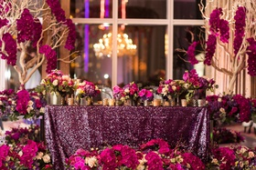 purple sequin linens, fuchsia flowers, trees with fuchsia orchids