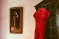 Red silk outfit with sequins hanging on cabinet