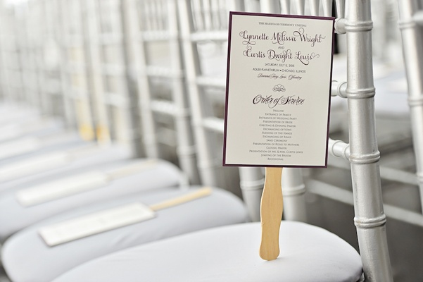 Fan wedding ceremony program with purple border, script on silver chair
