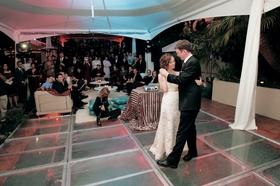 Bride and groom dancing under reception tent