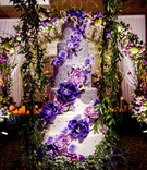 Wedding cake six layer purple flowers white fondant silver pearls greenery reception ideas swing