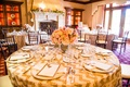 Wedding shower table with a floral arrangement of pink & white roses in golden vase