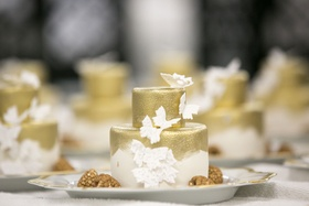 Wedding cake small gold with butterfly decorations gold paintbrush strokes style brushstrokes