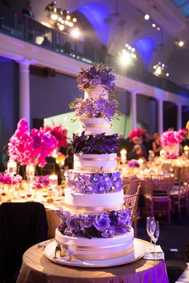 Ron Ben-Israel wedding cake with gold bands and purple surgar flowers