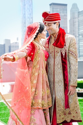 Indian-American bride and groom in traditional wedding attire