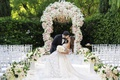wedding ceremony decor beverly hills hotel pink and white flowers groom dips bride kiss