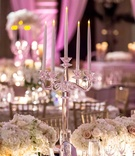 Electric candelabra with white & pink roses & hydrangeas in mirrored vessels on wedding reception