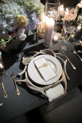 rustic wedding table setting antlers acting as charger plates