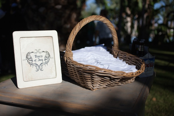 Wedding ceremony station with hankies and tears of joy sign