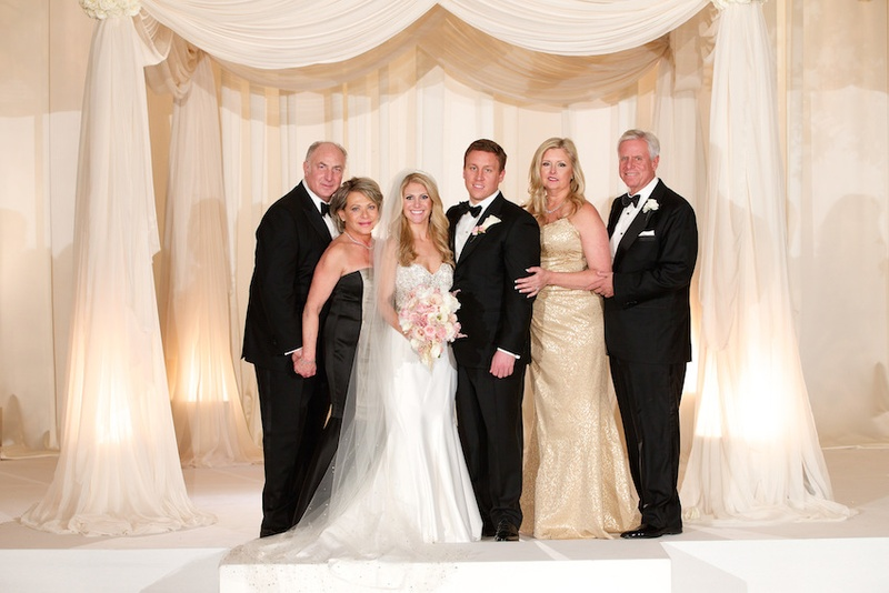 Bride and groom with mother of bride and father of bride