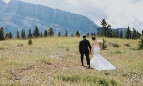 groom in Ermenegildo Zegna, bride in Watters, Banff National Park, open field, mountains