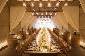 Rectangular table in vineyard barrel room