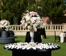 Black round table with pearl-filled vase