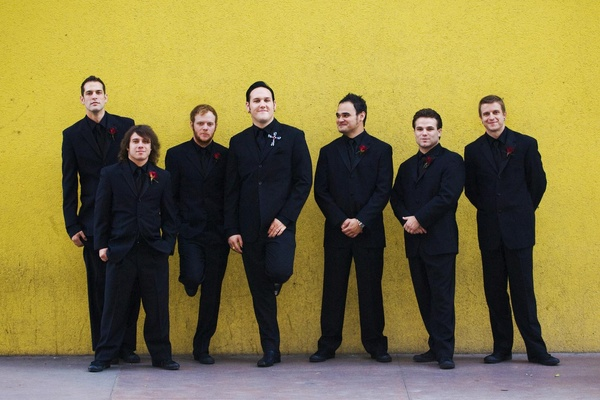 Brandon Saller, drummer of Atreyu, with his groomsmen