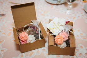 bridal shower favors box filled with flower soaps and pot pourri sash