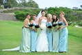 Trumpet/mermaid dress and bridesmaids on golf course