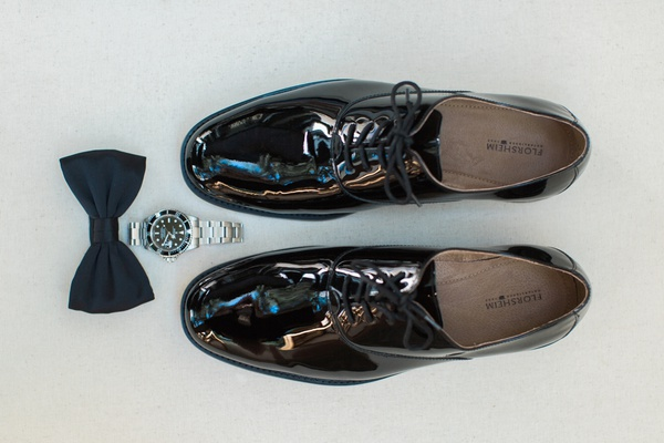 wedding photo detail shots, groom dress shoes, watch, black bow tie