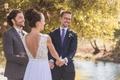 Bride in Mira Zwillinger wedding dress from Carine's Bridal Atelier low v-back holding hands groom