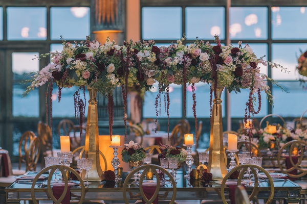 Henry Morrison Flagler Museum wedding, gold pillars with flowers across burgundy white ivory blush