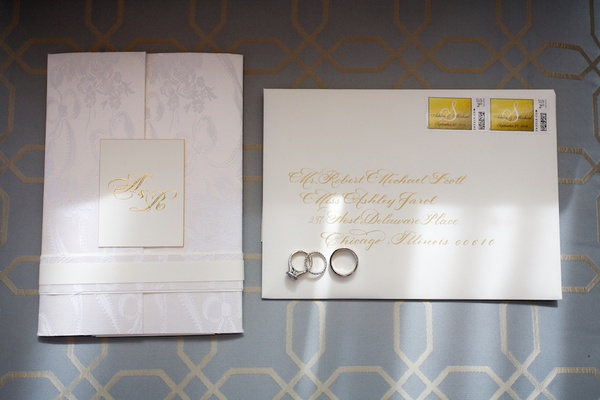 Tri-fold invite with white and gold plaque