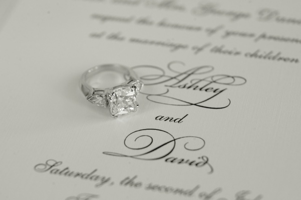 Princess cut bordered by oval side stones
