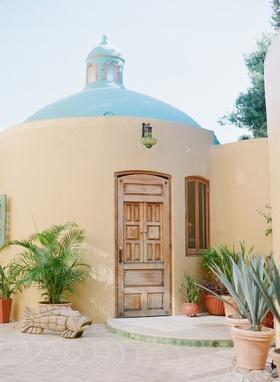 Wedding venue destination wedding in Riviera Nayarit, Mexico wood door adobe spanish style building