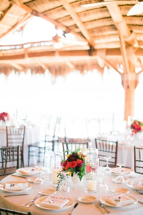 simple white tablescapes with pop of color in red yellow pink and green floral centerpiece