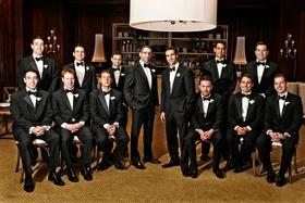 Twelve groomsmen in tuxes at Chicago club