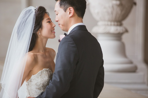 Korean bride in Kenneth Pool strapless wedding dress and groom on wedding day