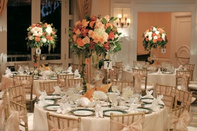 Ballroom with round tables and tall centerpieces