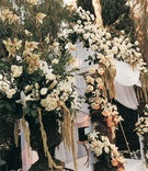White outdoor Jewish wedding canopy with flowers