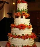 Ivory wedding cake with fresh tulip and ranunculus flowers