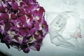 Purple lei, mints marked LOVE, and handkerchief