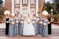 Bridesmaids wearing serenity grey bridesmaid dresses with bride in Vera Wang wedding dress