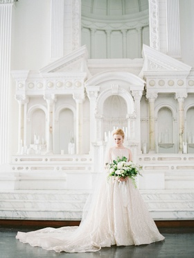 bride at vibiana altar in boat neck wedding dress lazaro cathedral veil greenery white flowers