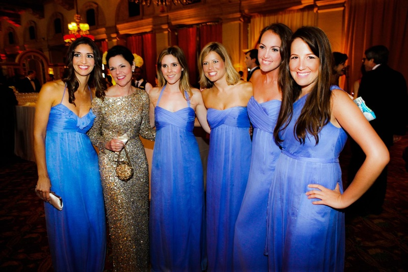 bridesmaids wear matching dresses in royal blue color