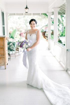 bride in illusion wedding dress lace with sheer neckline purple bouquet plantation porch hawaii