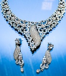 extravagant diamond necklace and chandelier earrings with blue details