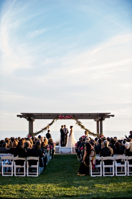 Bride and groom at wedding ceremony on lawn of Terranea