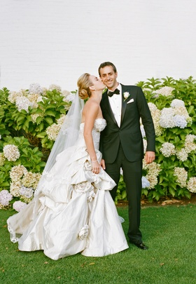 Bride in pick-up ball gown skirt with tuxedo groom