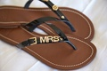 """custom brown sandals with black straps and custom gold detailing that says """"mrs"""" from tory burch"""